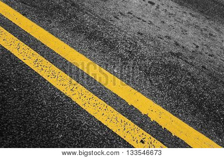 Yellow Double Dividing Line Over Black Highway
