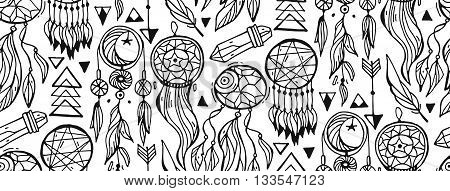 Seamless pattern with hand drawn native Indian-American dream catcher.Bo ho style pattern with arrowsfeathersgems and dream catchers.Black and white vector illustration.