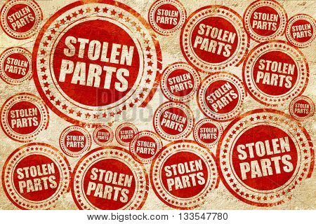 stolen parts, red stamp on a grunge paper texture