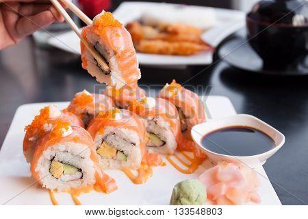 Eating sushi rolls. in Japanese food restaurant