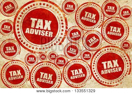 tax adviser, red stamp on a grunge paper texture