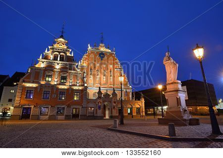 RIGA LATVIA - MARCH 10: Riga old town with the building of the Brotherhood of the Blackheads on March 10 2015 in Riga Latvia. The old town is the UNESCO world heritage sites.