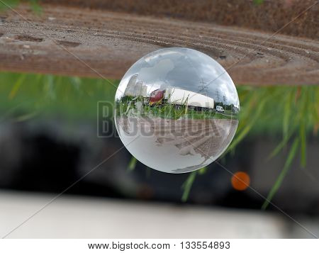 Transparent ball. Globe. Big truck - wagon is reflected in a bowl. Concept - trucking worldwide, transport links
