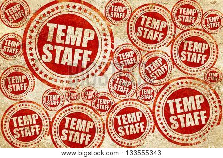 temp staff, red stamp on a grunge paper texture