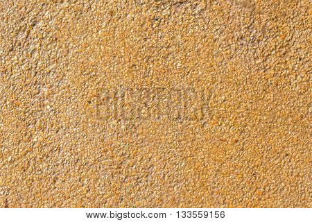 Natural sea sand texture with lacker rough textured surface of exposed aggregate finish Ground stone washed floor made of small sand stone.