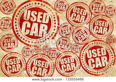 used car, red stamp on a grunge paper texture