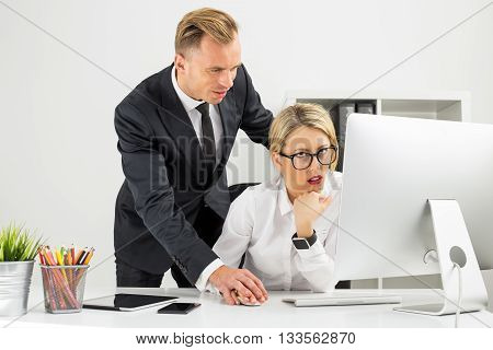 Office employee being annoyed by her boss