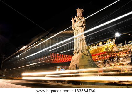 Temple Statue with lights from passing cars. Taichung Taiwan Asia
