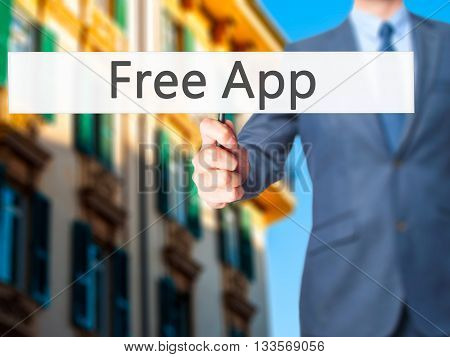 Free App - Businessman Hand Holding Sign