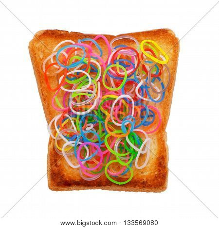 colored rubber bands on toasted bread. the concept of processed foods