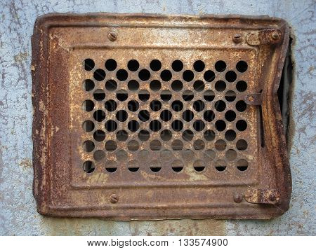 Old rusty metal ventilation grate (grill) .