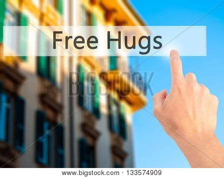 Free Hugs - Hand Pressing A Button On Blurred Background Concept On Visual Screen.