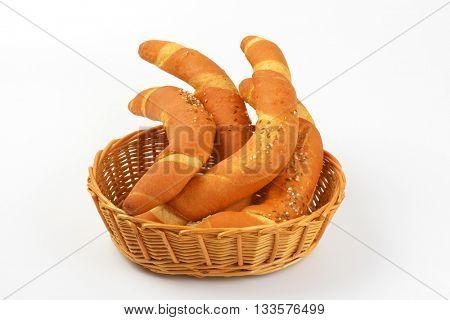 scuttle of fresh bread rolls on white background