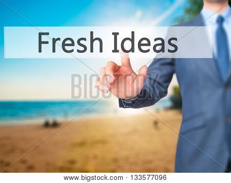 Fresh Ideas - Businessman Hand Pressing Button On Touch Screen Interface.
