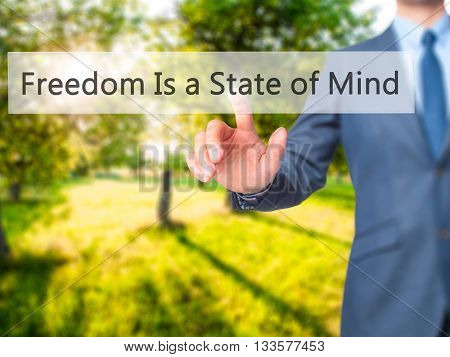 Freedom Is A State Of Mind - Businessman Hand Pressing Button On Touch Screen Interface.