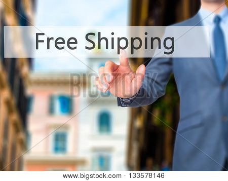 Free Shipping  - Businessman Hand Pressing Button On Touch Screen Interface.