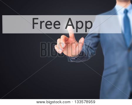 Free App - Businessman Hand Pressing Button On Touch Screen Interface.