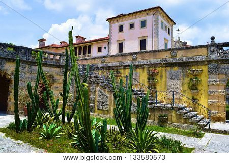 May 15, 2016 in Miami, FL:  Desert garden next to the Villa Vizcaya at the Vizcaya Museum and Gardens built in 1923 and is a US National Historic Landmark with its Spanish European architecture and where tourists can visit during visitor hours taken at th