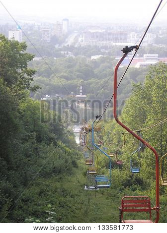 Ropeway, which goes from the mountains to the city park among the thickets of trees