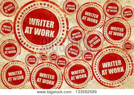 writer at work, red stamp on a grunge paper texture