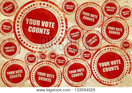 your vote counts, red stamp on a grunge paper texture