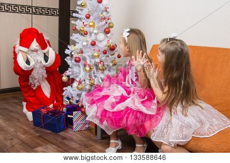 Two Girls Saw Santa Claus Who Brought Them Gifts