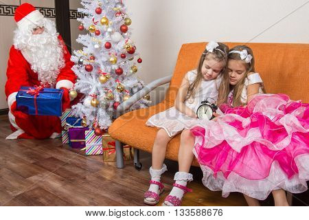 The Sisters Fell Asleep While Waiting For Santa Claus, Who Quietly Put Presents Under The Christmas