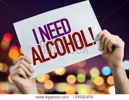 I Need Alcohol placard with night lights on background