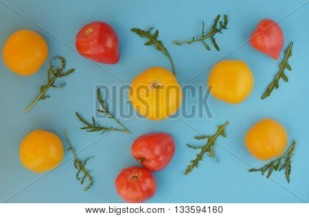 composition of red and yellow tomatoes on a bright background
