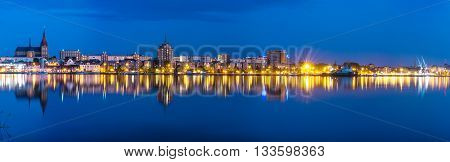 Night Panorama View to Rostock. River Warnow and City port. Mecklenburg-Vorpommern, Germany