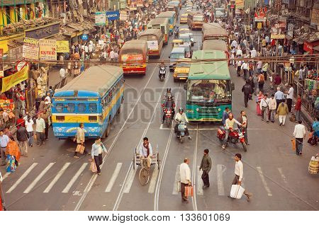 KOLKATA, INDIA - JAN 20, 2016: Crossroad of busy city in Asia with cars bikes walking people and buses on January 20, 2016 in Calcutta. Kolkata has a density of 814.80 vehicles per km road length