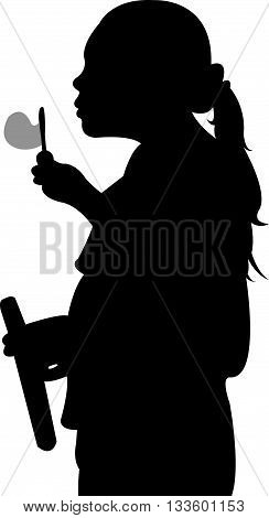 A Silhouette of a young girl blowing bubbles.