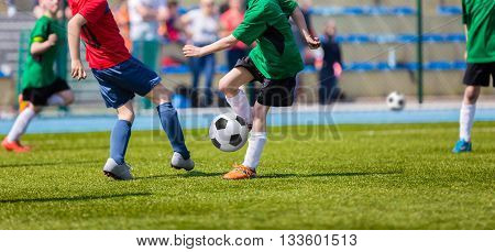 Football soccer match for children. Kids playing soccer game tournament cup. Sport competition. Red team against green one. Physical education classes at school.