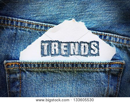 trends word on white paper in the pocket of blue denim jeans