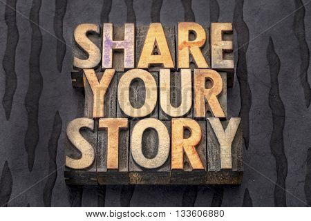 share your story - text in vintage letterpress wood type blocks against black Nepalese lokta paper
