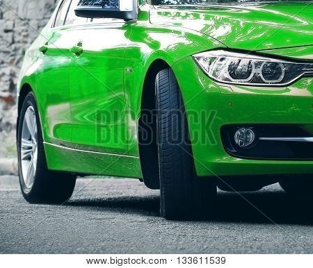 Green car, outdoors