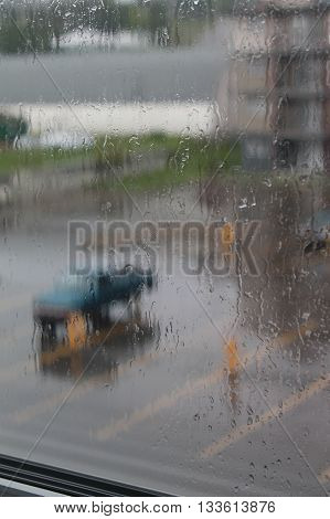 cool and rainy day with rain drops on a window