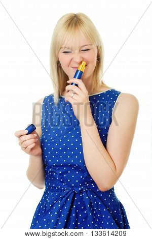 blond hair girl wears blue dress and sniffs perfume. Half-lenght portrait on white background, isolated