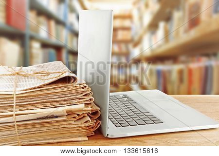 Laptop on table in library. Law or school concept