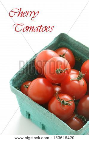 Basket of organic cherry tomatoes in vertical format with copy space
