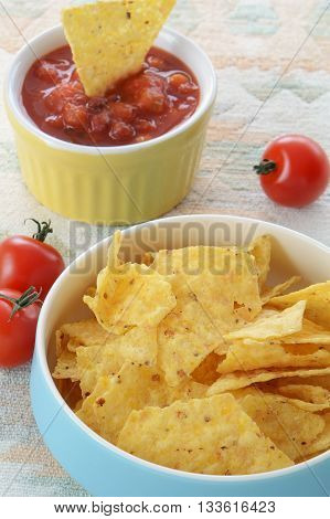 Organic corn chips with fresh home made salsa in vertical format