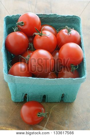 Basket of organic cherry tomatoes in vertical format