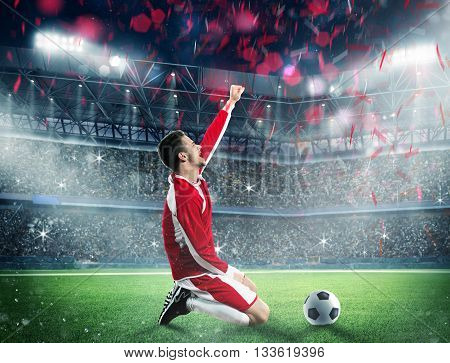 Soccer player exults on a stadium field