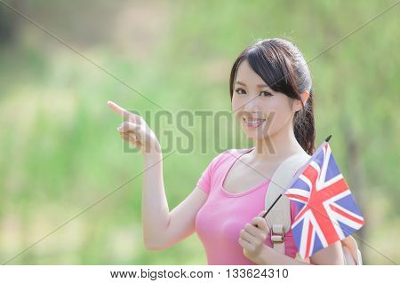 Happy College Student girl hold British flag and show something with nature white background asian