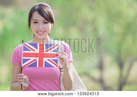 Happy College Student girl hold British flag with nature white background asian