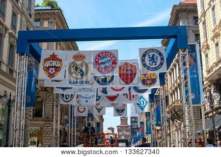Milan Italy - May 25 2016: UEFA Champions League 2016 Real Madrid-Atletico Madrid play in the final. The streets are decorated with banners flags football symbols. In the background is seen Sforza Castle.