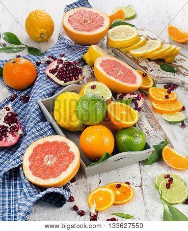 Citrus Fruits Onwhite Wooden Board.