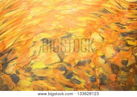 Close up of blown glass in yellow, orange and brown