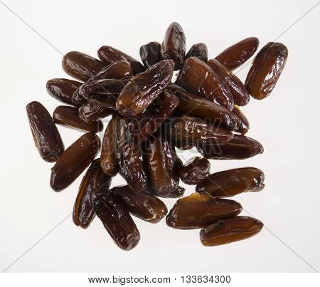 Dates on a White Background, dried and ready to eat