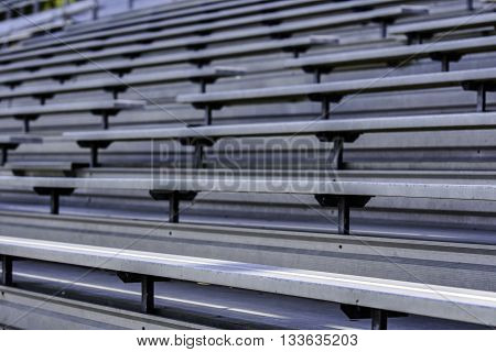 Rows of empty bleacher seating at a sporting venue